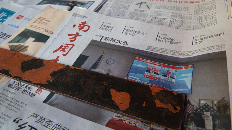 epa08810815 A front page of a Chinese newspaper showing a photo about the US Presidential election, in Beijing, China, 10 November 2020. Major news organizations have called the US presidential election 2020 for democrat Joe Biden, defeating incumbent US President Donald J. Trump.  EPA/ROMAN PILIPEY