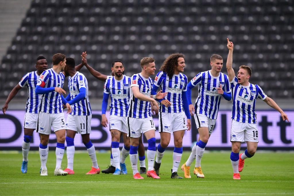 BERLIN, GERMANY - APRIL 10: Santiago Ascacibar of Hertha Berlin (R) celebrates with teammates after scoring their team's first goal  during the Bundesliga match between Hertha BSC and Borussia Moenchengladbach at Olympiastadion on April 10, 2021 in Berlin, Germany. Sporting stadiums around Germany remain under strict restrictions due to the Coronavirus Pandemic as Government social distancing laws prohibit fans inside venues resulting in games being played behind closed doors.  (Photo by Clemens Bilan - Pool/Getty Images)