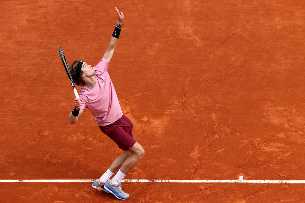 MONTE-CARLO, MONACO - APRIL 17: Andrey Rublev of Russia serves during the semi-final match against Casper Ruud of Norway  on day seven of the Rolex Monte-Carlo Masters at Monte-Carlo Country Club on April 17, 2021 in Monte-Carlo, Monaco. Sporting stadiums around Monaco remain under strict restrictions due to the Coronavirus Pandemic as Government social distancing laws prohibit fans inside venues resulting in games being played behind closed doors. (Photo by Alexander Hassenstein/Getty Images)
