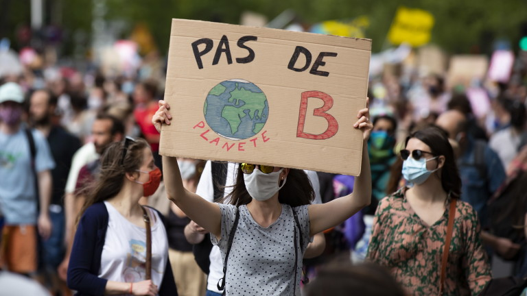 epa09188011 Protesters take part in a Climate March demonstration against global warming, demanding climate justice, in Paris, France, 09 March 2021. Placard reads 'No Planet B'. Activists organized a protest after the National Assembly (lower house of the Parliament) voted on a climate bill that activists said did not include enough measures against climate change and cutting greenhouse gas emissions.  EPA/IAN LANGSDON