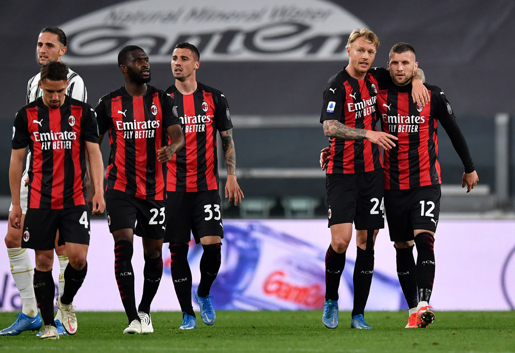 TURIN, ITALY - MAY 09: Ante Rebic of A.C. Milan celebrates with Simon Kjaer after scoring their side's second goal during the Serie A match between Juventus  and AC Milan at  on May 09, 2021 in Turin, Italy. Sporting stadiums around Italy remain under strict restrictions due to the Coronavirus Pandemic as Government social distancing laws prohibit fans inside venues resulting in games being played behind closed doors. (Photo by Valerio Pennicino/Getty Images)