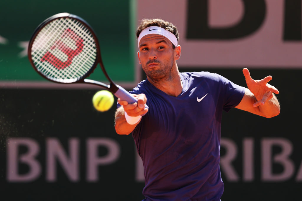 PARIS, FRANCE - MAY 30: Grigor Dimitrov of Bulgaria plays a forehand in his First Round match against Marcos Giron of The United States during Day One of the 2021 French Open at Roland Garros on May 30, 2021 in Paris, France. (Photo by Clive Brunskill/Getty Images)