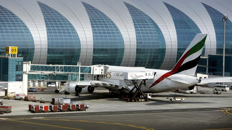 An Emirates plane is parked at the new Concourse A of Dubai airport in Dubai, United Arab Emirates, Sunday, Feb. 10, 2013. Dubai's airport authorities say a purpose-build concourse for Airbus' A380 aircraft is fully open after weeks of phased-in operations. (AP Photo/Kamran Jebreili)