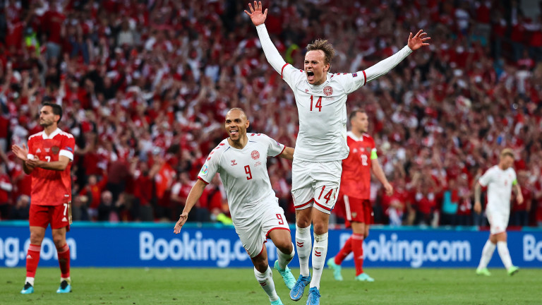 COPENHAGEN, DENMARK - JUNE 21: Mikkel Damsgaard of Denmark celebrates with teammate Martin Braithwaite after scoring their side's first goal during the UEFA Euro 2020 Championship Group B match between Russia and Denmark at Parken Stadium on June 21, 2021 in Copenhagen, Denmark. (Photo by Wolfgang Rattay - Pool/Getty Images)