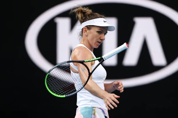 MELBOURNE, AUSTRALIA - JANUARY 21:  Simona Halep of Romania throws her racquet during her Women's Singles first round match against Jennifer Brady of the United States on day two of the 2020 Australian Open at Melbourne Park on January 21, 2020 in Melbourne, Australia. (Photo by Clive Brunskill/Getty Images)