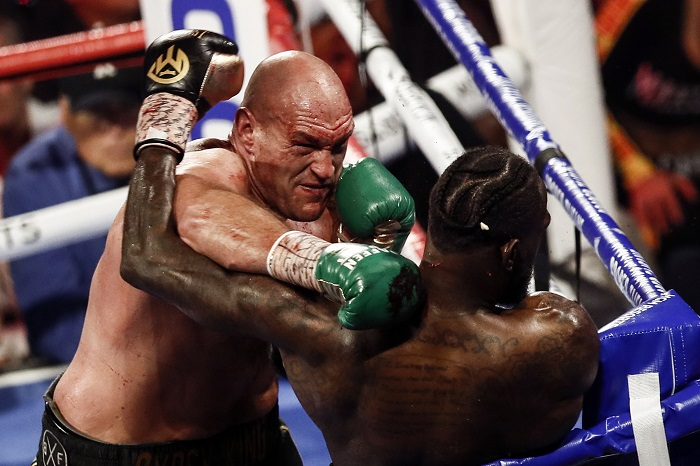epa08239652 Tyson Fury of Britain (L) in action against Deontay Wilder of the USA (R) during the WBC World Heavyweight Championship title fight at the Garden Arena in Las Vegas, Nevada, USA, 22 February 2020.  EPA/ETIENNE LAURENT