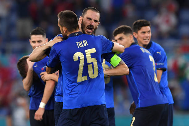 ROME, ITALY - JUNE 16: Leonardo Bonucci and Rafael Toloi of Italy celebrate their team's third goal, scored by team mate Ciro Immobile (obscured) during the UEFA Euro 2020 Championship Group A match between Italy and Switzerland at Olimpico Stadium on June 16, 2021 in Rome, Italy. (Photo by Chris Ricco - UEFA/UEFA via Getty Images)