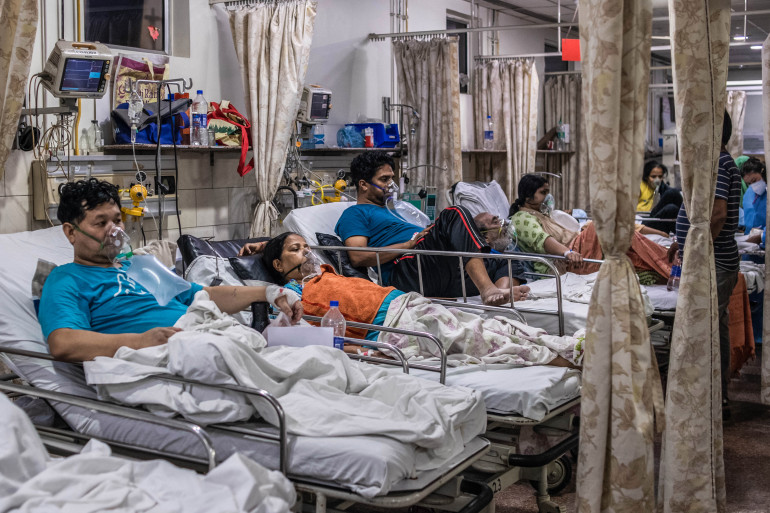 NEW DELHI, INDIA - MAY 03: Patients who contracted the coronavirus lie in beds while connected to oxygen supplies inside the emergency ward of a Covid-19 hospital on May 03, 2021 in New Delhi, India. India recorded more than 360,000 coronavirus cases in a day for the 12th day in a row as the total number of those infected according to Health Ministry data neared 20 million. The real figure could be up to ten times higher, many health experts say, due to a lack of widespread testing or reporting, and only patients who succumbed in hospitals being counted. A new wave of the pandemic has totally overwhelmed the country's healthcare services and has caused crematoriums to operate day and night as the number of victims continues to spiral out of control. (Photo by Rebecca Conway/Getty Images)