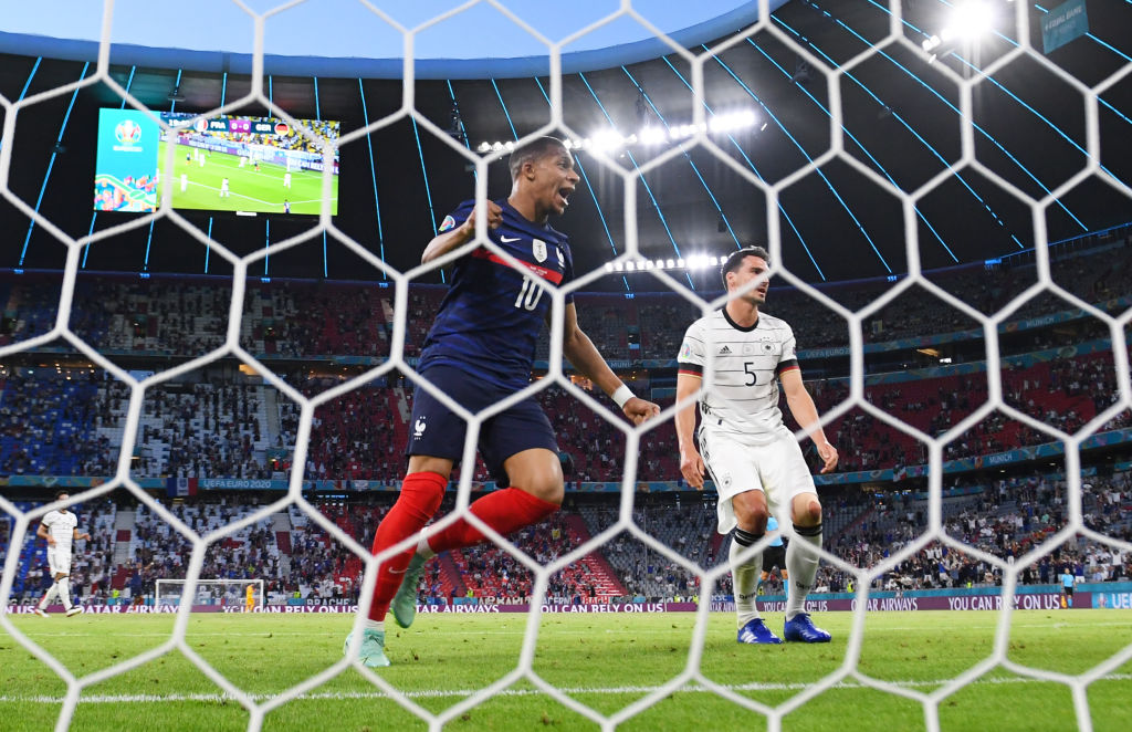 MUNICH, GERMANY - JUNE 15: Kylian Mbappe of France celebrates their side's first goal, an own goal by Mats Hummels of Germany during the UEFA Euro 2020 Championship Group F match between France and Germany at Football Arena Munich on June 15, 2021 in Munich, Germany. (Photo by Matthias Hangst/Getty Images)