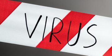 Label virus. Red and white warning tape with the inscription virus close up on black background. Concept for protecting people from coronavirus infection. Coronavirus, Covid-19