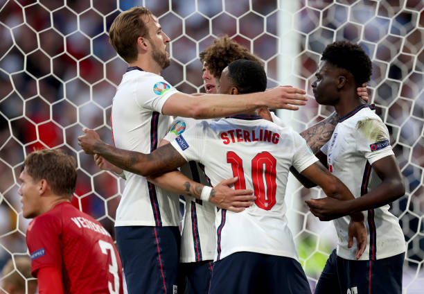 LONDON, ENGLAND - JULY 07: Harry Kane, Raheem Sterling, Kalvin Phillips and Bukayo Saka of England celebrate their side's first goal, an own goal by Simon Kjaer of Denmark (not pictured) during the UEFA Euro 2020 Championship Semi-final match between England and Denmark at Wembley Stadium on July 07, 2021 in London, England. (Photo by Eddie Keogh - The FA/The FA via Getty Images)