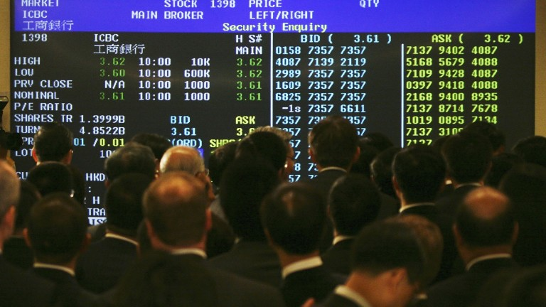HONG KONG, CHINA - OCTOBER 27:  Guests look at the electronic billboard showing the Industrial and Commercial Bank Of China's (ICBC) stock price after the ceremony to mark their Initial Public Offering (IPO), at Hong Kong Stock Exchange on October 27, 2006 in Hong Kong, China. ICBC was simultaneously listed on both the Hong Kong Stock Exchange and Shanghai Stock Exchange today in what is the world's largest ever Initial Public Offering (IPO). Shares were priced at HKD3.07.  (Photo by MN Chan/Getty Images)