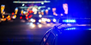 night police car lights in city - close-up with selective focus and bokeh background blur